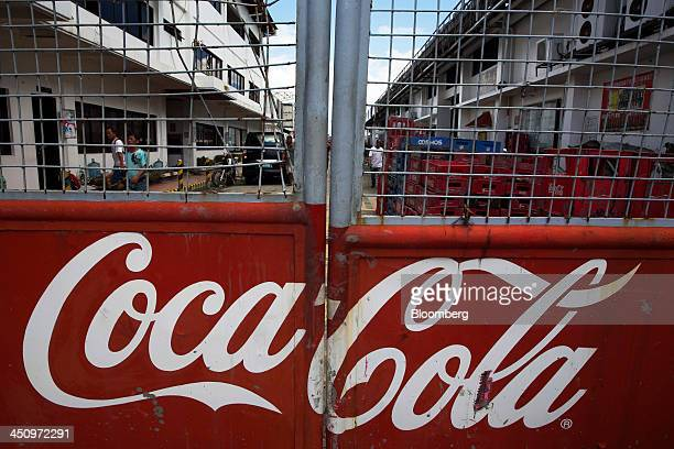 The CocaCola Co logo is displayed on a closed gate at the CocaCola Bottlers Philippines Inc facility in Tacloban the Philippines on Monday Nov 18...