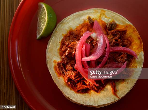 The cochinito pork taco with pickled onions on top at La Calle Taqueria y Carnitas 1565 W Alameda Ave in Denver on Tuesday May 12 2015 I