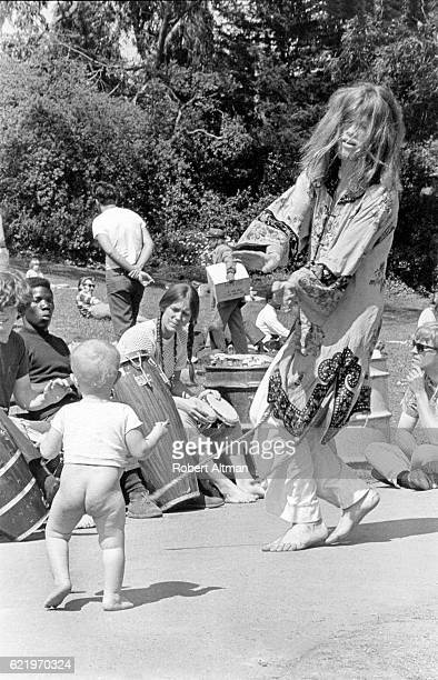 The Cockettes American theatre group Hibiscus dances with a baby at Golden Gate Park on April 20 1969 in San Francisco California