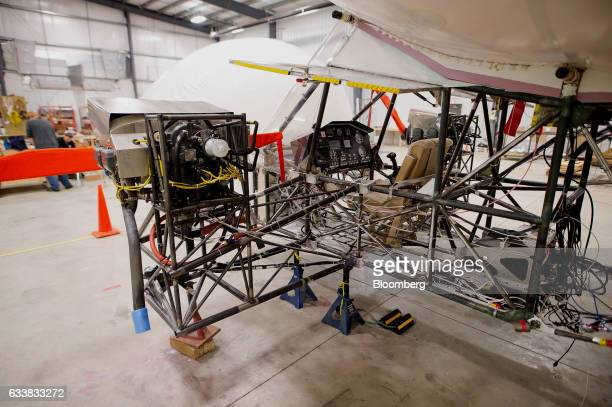 The cockpit and two outboard motors of a Solar Ship Inc test aircraft is seen inside the company's assembly and testing hangar in Brantford Ontario...