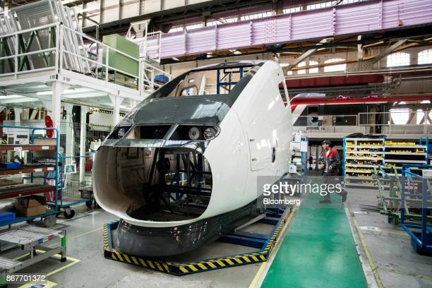 The cockpit bodywork of a TGV railway train stands during assembly on the production line inside the Alstom SA high-speed factory in Belfort, France,...