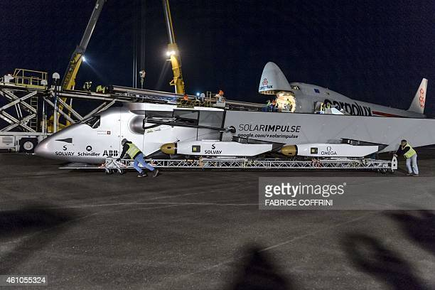 The Cockpit element of the solarpowered plane the Solar Impulse 2 is loaded to Cargolux Boeing 747 cargo aircraft on January 5 2015 at Payerne...