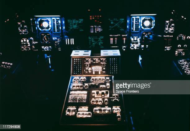 The cockpit interior of a NASA space shuttle circa 1985