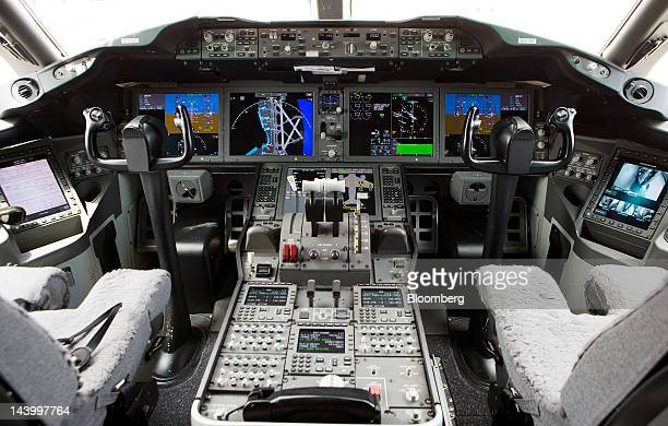 The cockpit of a Boeing Co 787 Dreamliner is shown during an event at Reagan National Airport in Arlington Virginia US on Monday May 7 2012 Jim...