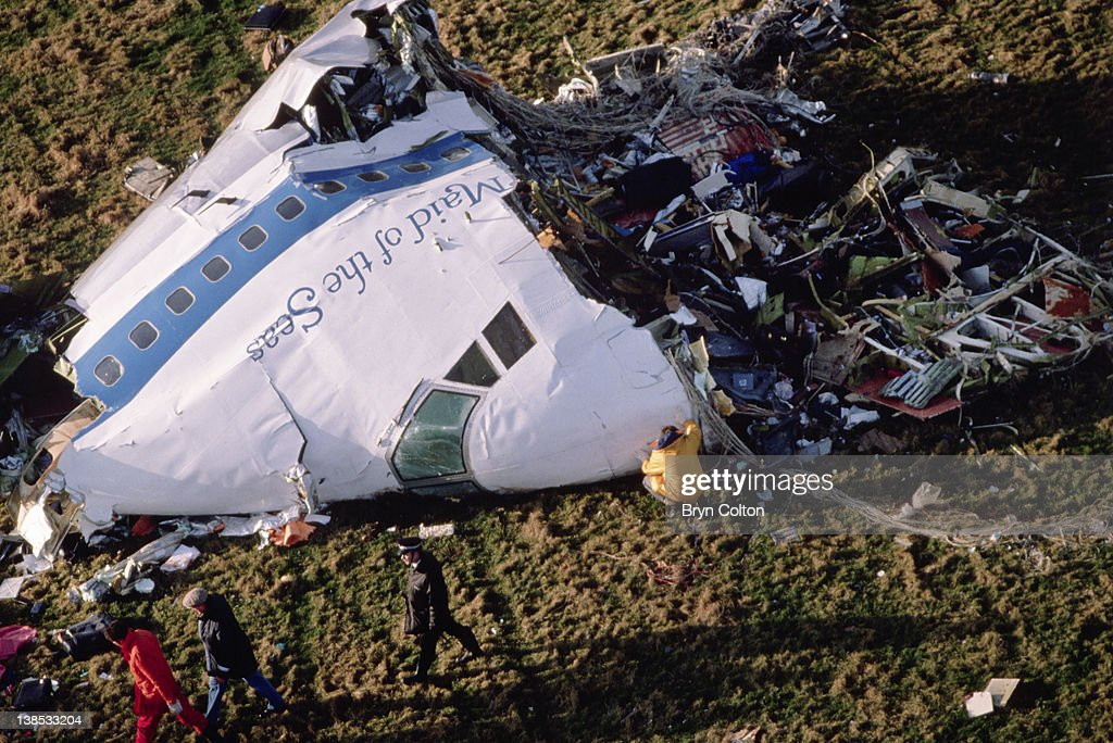 The cockpit section of 'Clipper Maid of the Seas, Pan Ams flight 103 is inspected by police and specialists as it lay on the ground following a midair explosion over the village of Lockerbie, Dumfries and Galloway, United Kingdom, on Thursday, December 22, 1988.