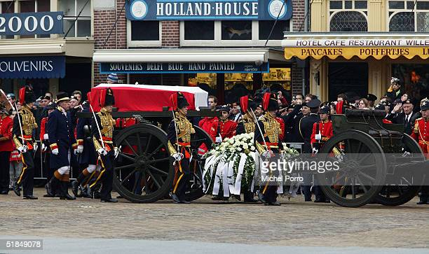 The coffin carrying Queen Beatrix's father Prince Bernhard rides past souvenir shops on the way to the funeral on December 11 2004 in Delft The...
