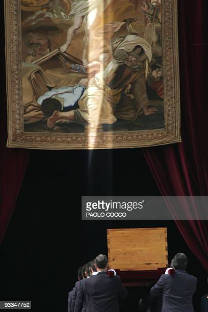 The coffin carrying the body of Pope John Paul II is taken inside St Peter's Basilica at the Vatican City 08 April 2005 after the funeral mass The...