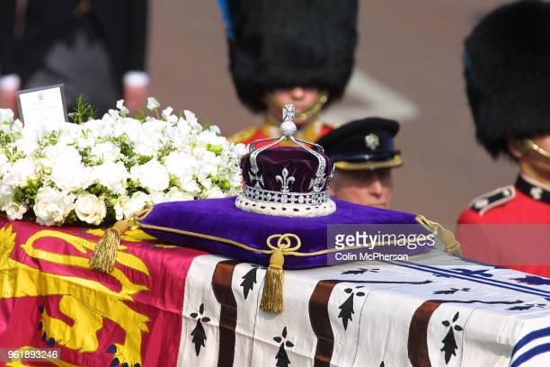 The coffin carrying the Queen Mother departs from St. James Palace, followed by members of the Royal Family.