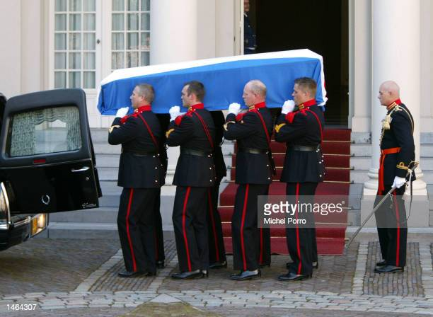 The coffin containing the body of Prince Claus of The Netherlands is taken from the hearse at Noordeinde Palace where he will lie in state October 8...