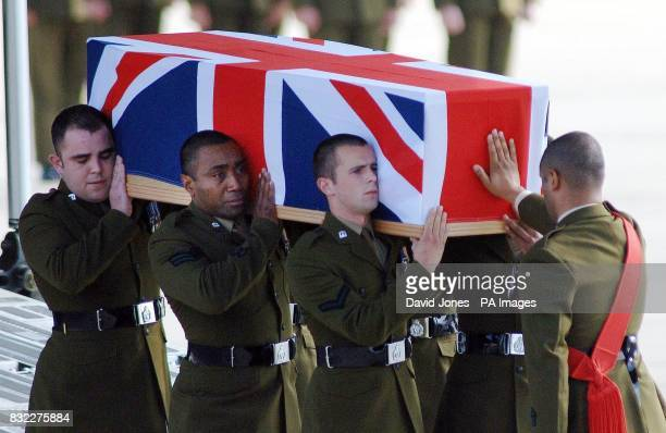 The coffin containing the body of Ranger Anara Draiva of the 1st Battalion Royal Irish Regiment is carried from a C17 transport plane at RAF Brize...