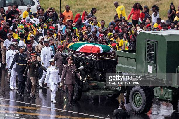 The coffin containing the body of the antiapartheid icon Winnie MadikizelaMandela is escorted at the burial site at the end of her official funeral...