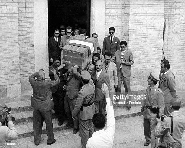 The coffin containing the remains of Benito Mussolini is moved from the family chapel to the crypt in San Cassiano in Pennino, in the presence of...