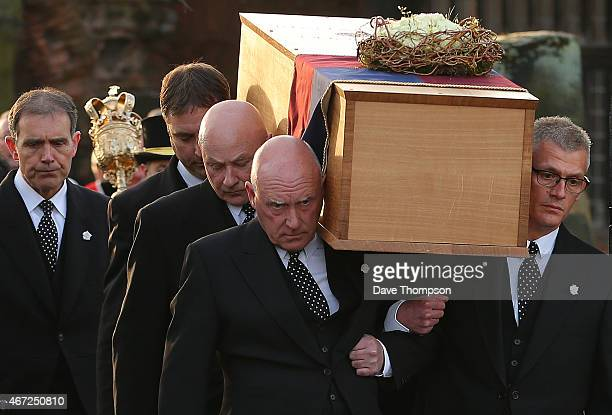 The coffin containing the remains of King Richard III is carried by pallbearers from St Nicholas Church during a procession through Leicester City...