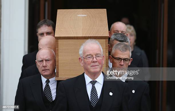 The coffin containing the remains of King Richard III is carried from the Fielding Johnson Building at the University of Leicester as it starts it's...