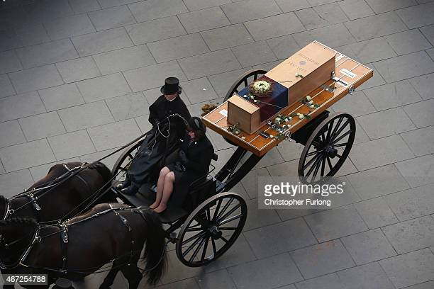 The coffin containing the remains of King Richard III is carried in procession for interment at Leicester Cathedral on March 22 2015 in Leicester...