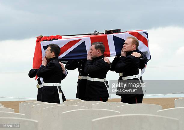 The coffin containing the remains of Lieutenant John Harold Pritchard is carried on April 23 2013 in the Honourable Artillery Company Cemetery at...
