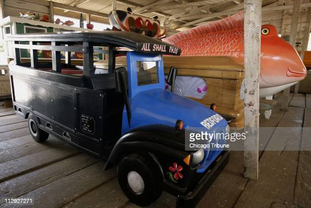 The coffin for a driver a truck and the coffin for a fisherman a fish are among the unusual coffins on display May 2 at Paa Joe's coffin shop in...