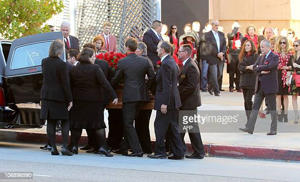 The coffin for Dino De Laurentiis is carried to a hearst during the funeral for the Italianborn film producer at the Cathedral of Our Lady of the...