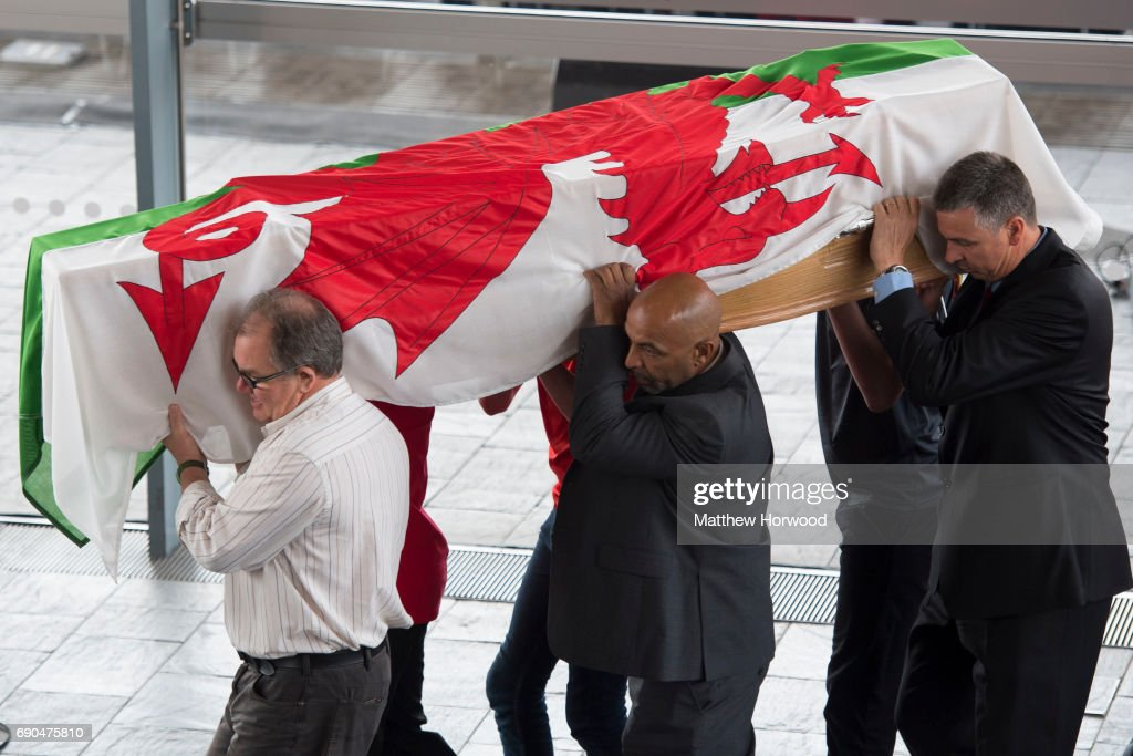 The coffin is carried in during the funeral of former First Minister of Wales Rhodri Morgan at the Senedd in Cardiff Bay on May 31 2017 in Cardiff...