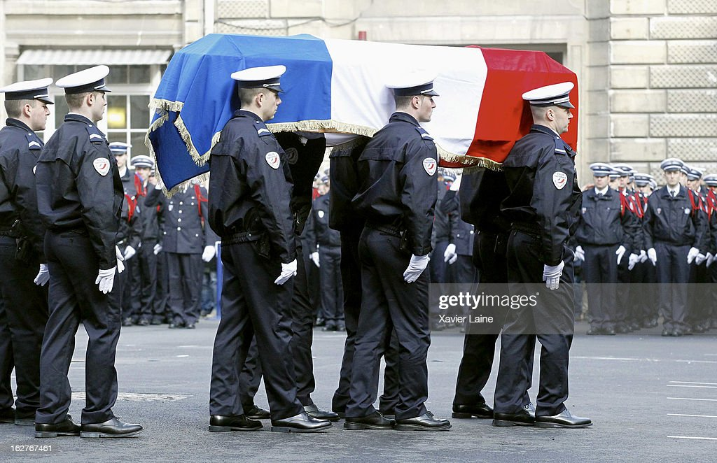 The coffin leaves after the funerals of two French policemen killed in a Paris car chase, at Prefecture de Police on February 26, 2013 in Paris, France. The two officers were killed after their vehicle collided with a car they were chasing on the peripherique, the capital's main ring road, on Thursday February 21.