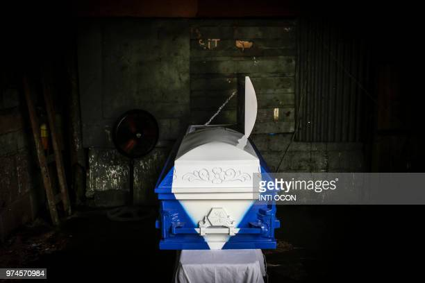 The coffin of 22yearold Agustin Mendoza who was shot dead during antigovernment protests is pictured during his wake in Tipitapa about 25 km from...