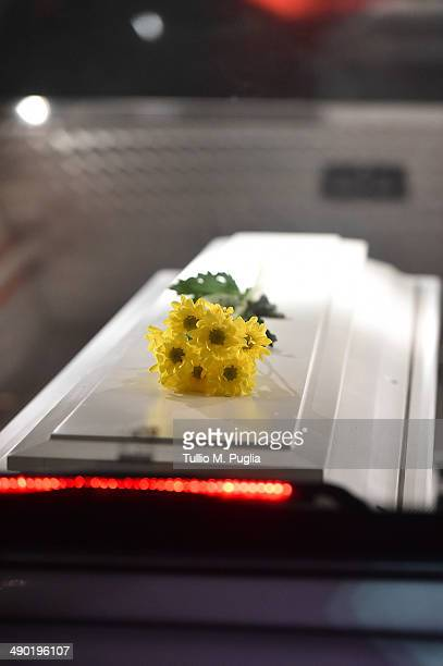 The coffin of a child lies in a hearse after disembarking from of Italian Navy Ship Grecale arriving in the Port of Catania carrying 206 migrants and...