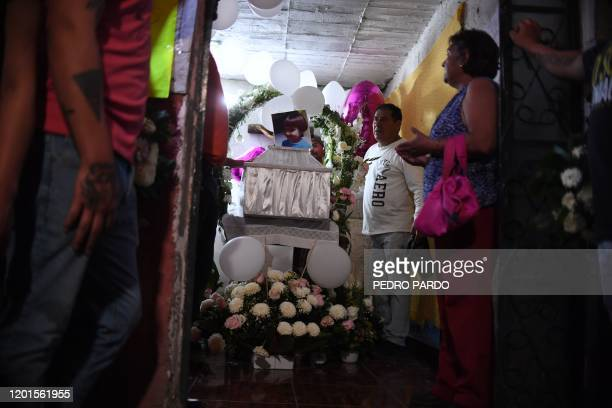 The coffin of a sevenyearold girl whose body was found over the weekend with signs of torture is seen during her funeral in the municipality of...