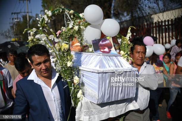The coffin of a seven-year-old girl whose body was found over the week-end with signs of torture, is carried to the cemetery for her burial in...