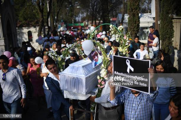 TOPSHOT The coffin of a sevenyearold girl whose body was found over the weekend with signs of torture is carried at the cemetery before her burial in...