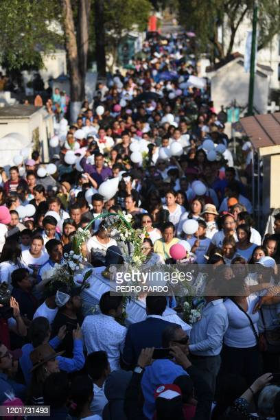 The coffin of a sevenyearold girl whose body was found over the weekend with signs of torture is carried at the cemetery before her burial in Mexico...