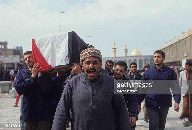 The coffin of a victim of Allied forces bombing raids, draped in an Iraqi flag, in the Imam Hussein shrine in Karbala, 24th February 1991. The bodies...