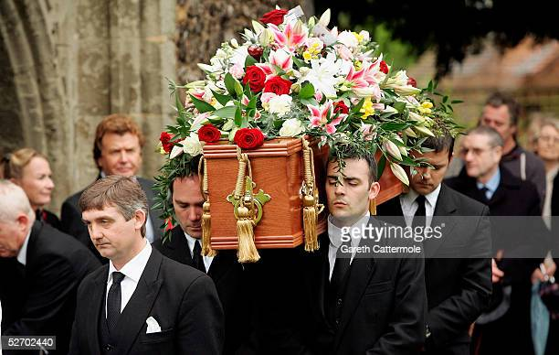 The coffin of actor Sir John Mills is carried through the grounds of The Parish Church of Saint Mary the Virgin during his funeral on April 27 2005...