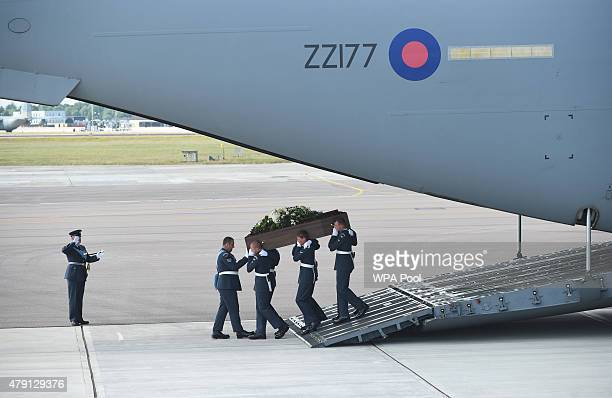 The coffin of Adrian Evans one of the victims of last Friday's terrorist attack is taken from the RAF C17 aircraft at RAF Brize Norton in Tunisia on...