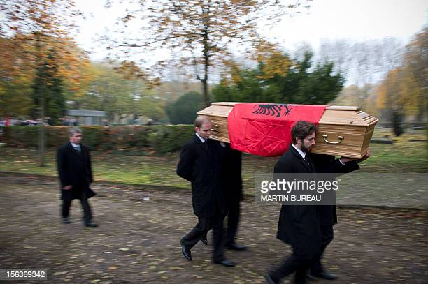 The coffin of Albanian King Zog I is carried after being exhumed at the cemetery of Thiais on November 14 2012 Albania will repatriate today the...