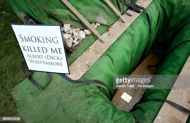 The coffin of Albert 'Dick' Whittamore lies in his grave at St Mary's Cemetery in Dover Kent following a burial service after he died from the lung...