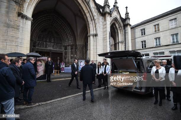 The coffin of Alexia Daval a young jogger found murdered near the city arrives at the basilica Notre Dame in Gray on November 8 2017 / AFP PHOTO /...