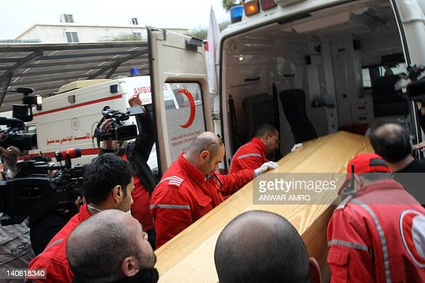 The coffin of American journalist Marie Colvin of the Sunday Times is carried on to an ambulance in Damascus on March 3 2012 Human Rights Watch...