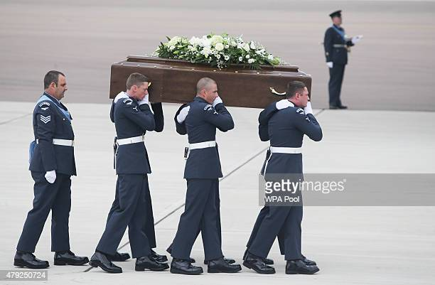 The coffin of Ann McQuire is taken from the RAF C17 aircraft after it landed at RAF Brize Norton carrying nine of the victims of last Friday's...