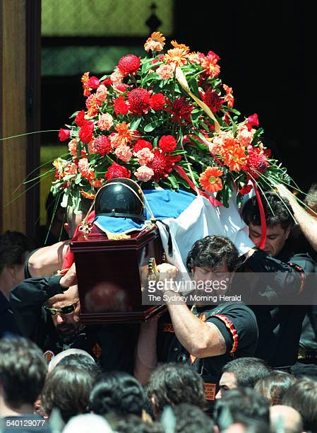 The coffin of Bandidos bikie member Sasha Milenkovic is carried from the and the coffin is carried from the Serbian Orthodox Church Cabramatta Sydney...