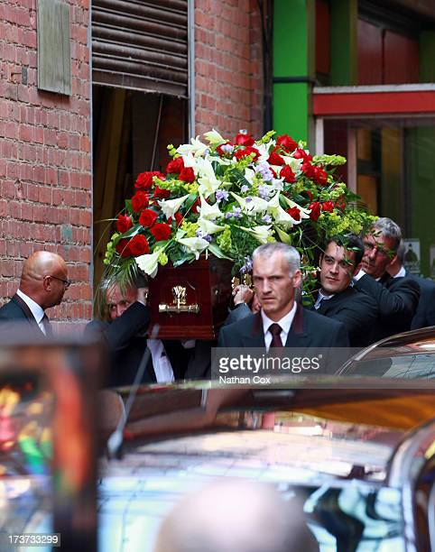 The coffin of Bernie Nolan is carried during a funeral service at Grand Theatre on July 17 2013 in Blackpool England