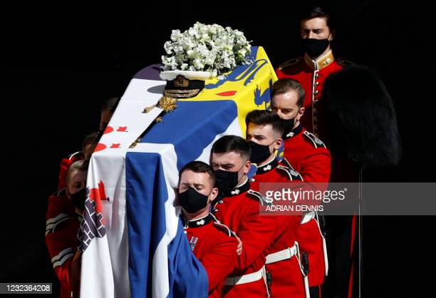The coffin of Britain's Prince Philip, Duke of Edinburgh is laid onto a modified Land Rover Defender in the quadrangle ahead of the ceremonial...