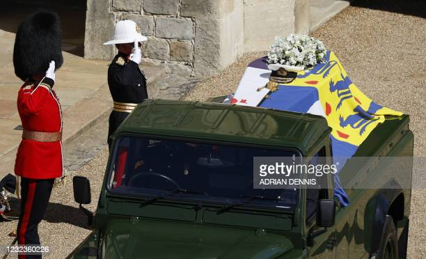 The coffin of Britain's Prince Philip, Duke of Edinburgh lays onto a modified Land Rover Defender in the quadrangle ahead of the ceremonial funeral...