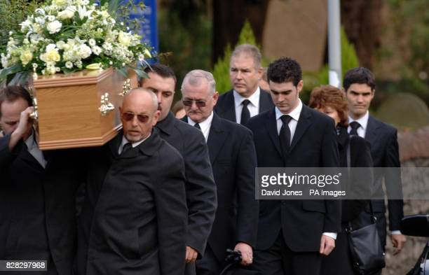 The coffin of British backpacker Katherine Horton is followed by her brothers Christopher and Richard as it is carried from the funeral service at St...