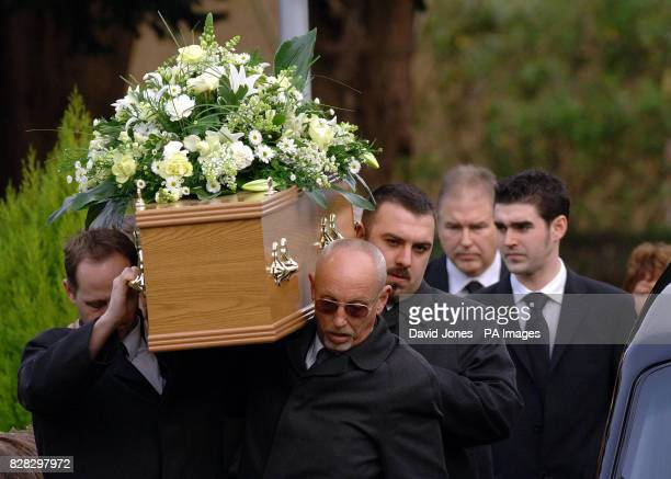 The coffin of British backpacker Katherine Horton is followed by her father Ian and brother Christopher as it is carried from the funeral service at...