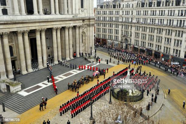 The coffin of British former prime minister Margaret Thatcher carried on a gun carriage drawn by the King's Troop Royal Horse Artillery arrives at St...