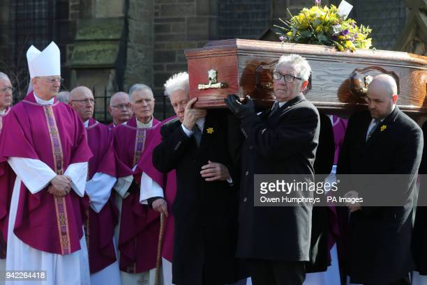 The coffin of Cardinal Keith O'Brien leaves the Church of St Michael in Newcastle after his funeral service
