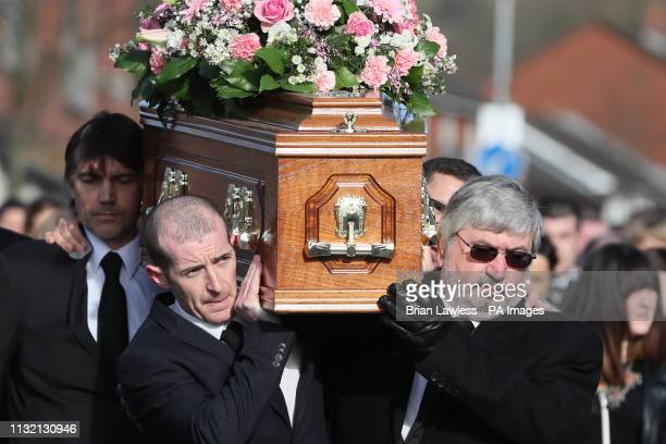 The coffin of Carlingford drowning victim Ruth Maguire is carried by her partner James Griffin and father Malachy as it makes it way to Saint Vincent...