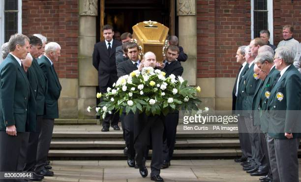 The coffin of Celtic legend Bobby Murdoch is carried by his two sons Barrie and Bobby past a guard of honour of his former teammates outside St...