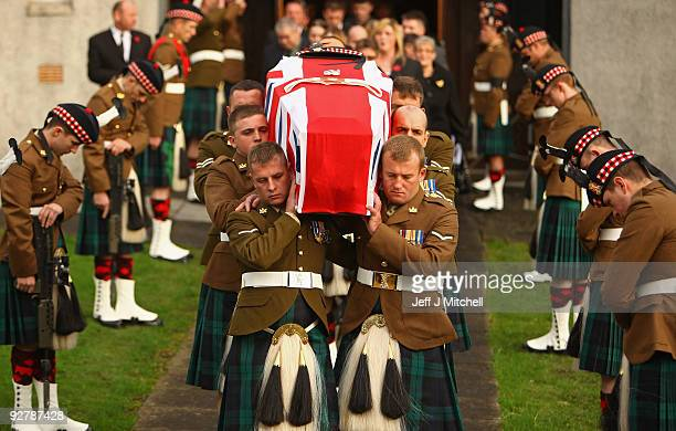 The coffin of Corporal Thomas Mason is carried from Trinity Parish Church on November 5 2009 in Cowdenbeath in Scotland Corporal Mason 27 was serving...