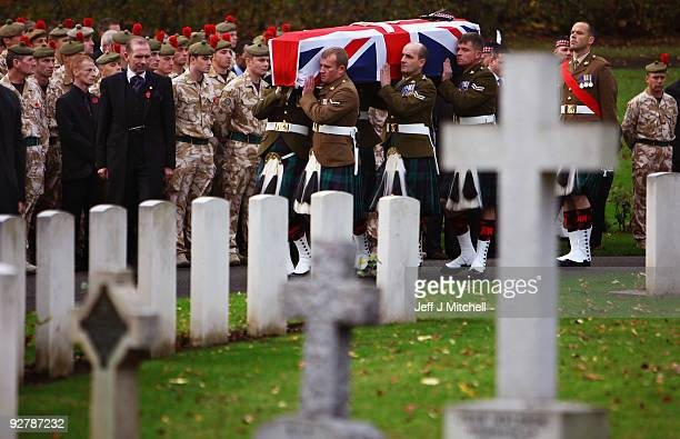 The coffin of Corporal Thomas Mason is carried into Douglas Bank Cemetery on November 5 2009 in Cowdenbeath in Scotland Corporal Mason 27 was serving...
